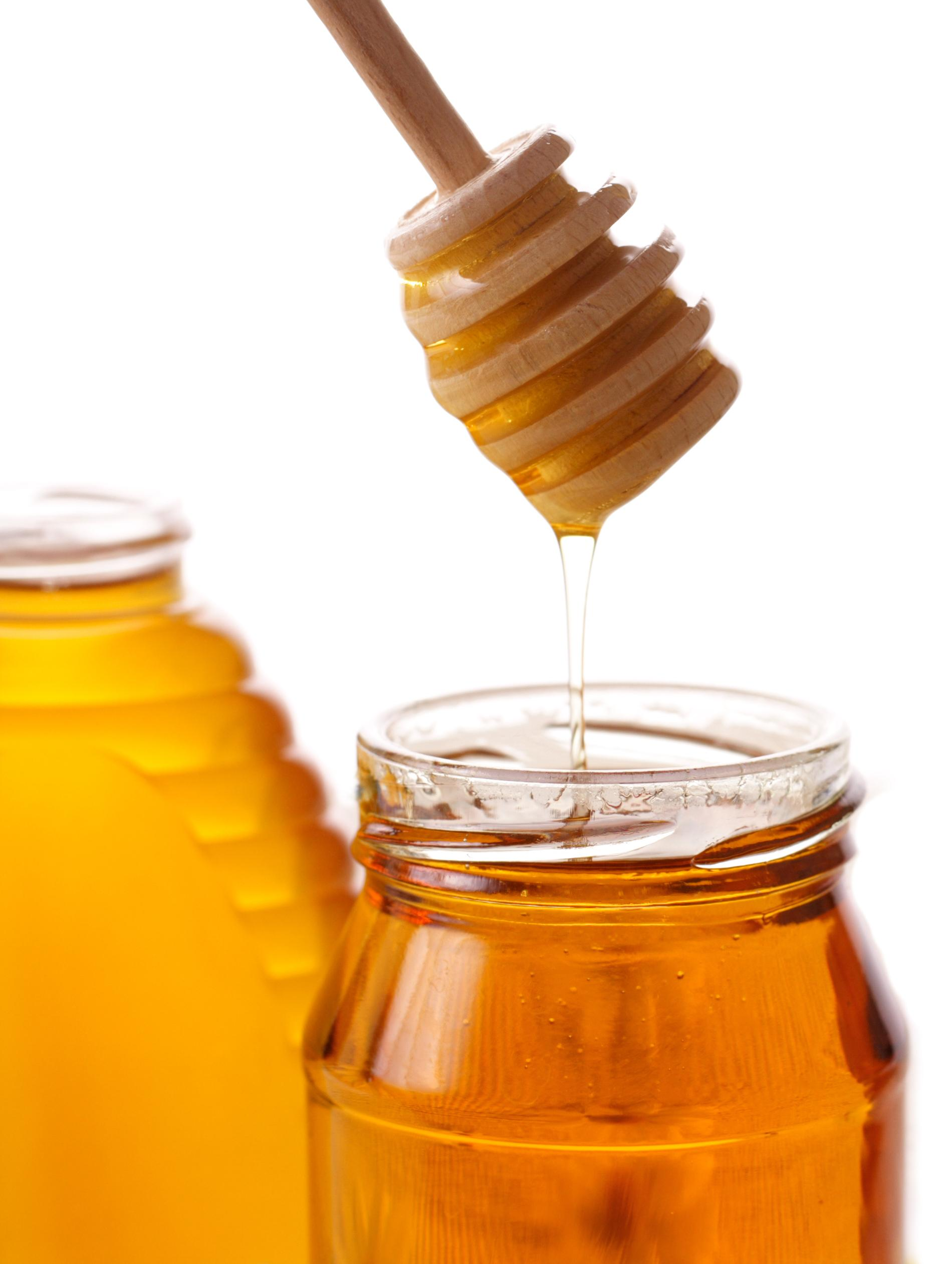 Honey in a Jar with a honey ladle